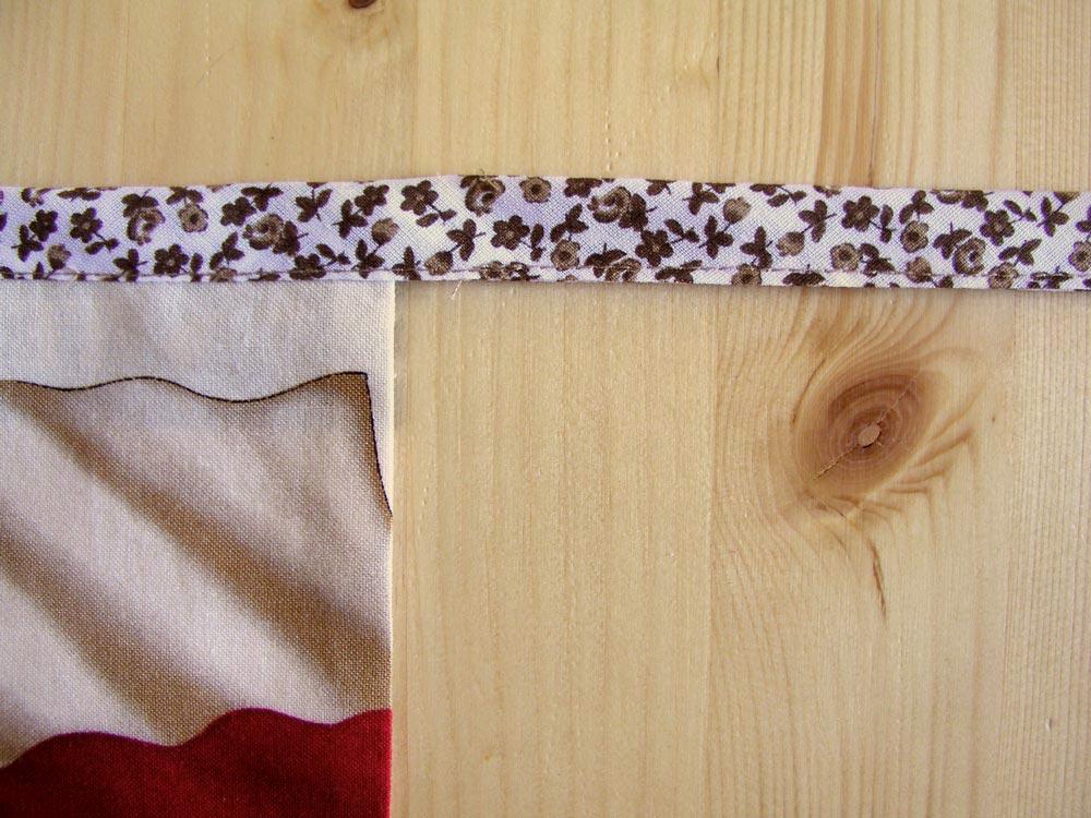 Coser lados cinta de la banderola