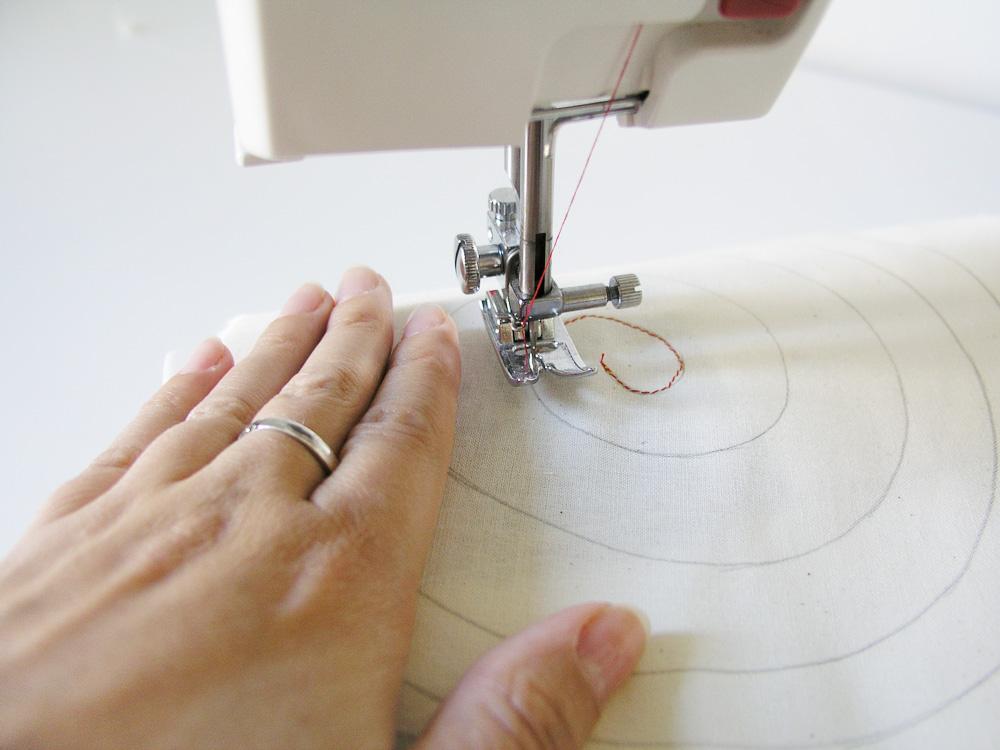 Pivotar aguja en el centro de la espiral