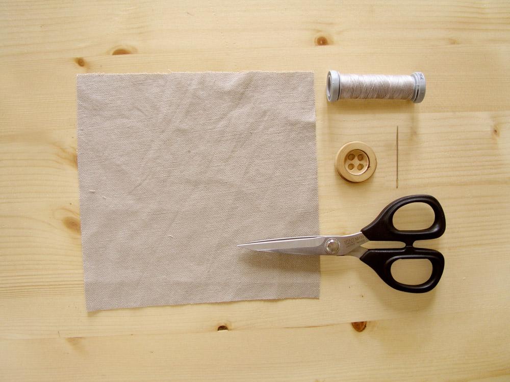 Material para coser un botón