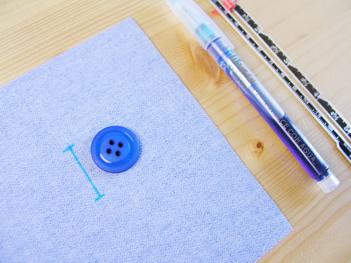 botón ojal ojales marcar tejido rotulador medida diámetro regla tiza